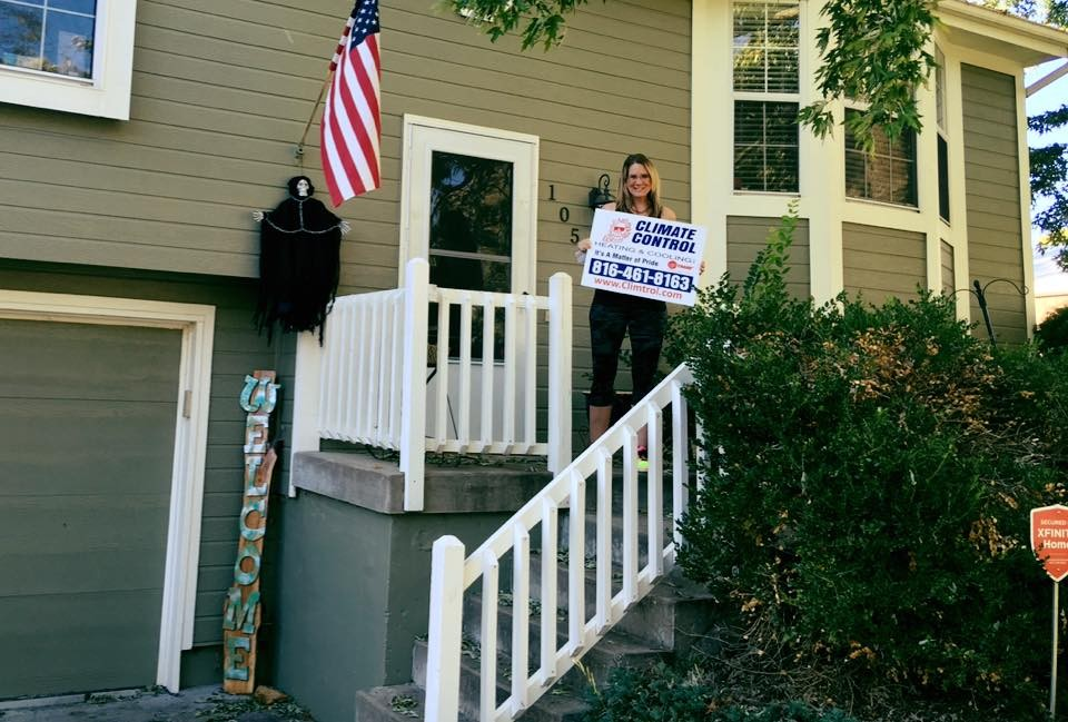 Happy Customer holding Climate Control sign