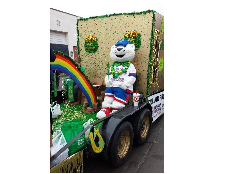 Climate Control mascot on float