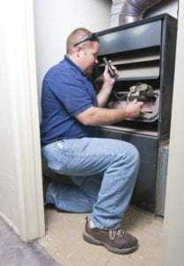 technician-inspects-furnace-safely