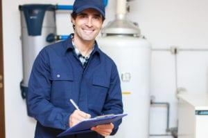 Technician-servicing-water-heater